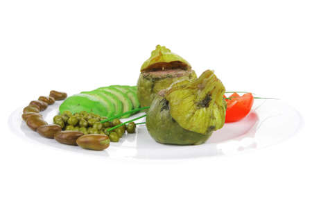gourmet food: zucchini filled with mince meat on white dish with beans and peas photo