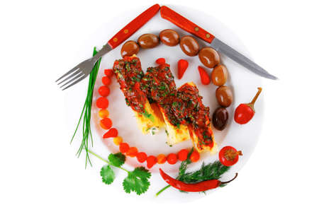 baked cannelloni served with pepper and tomato photo