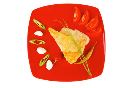 food : cheese casserole piece over red plate served with chives , tomatoes and hot peppers isolated over white photo