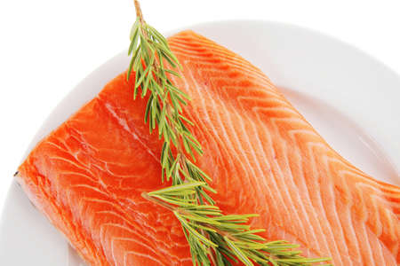 raw big salmon bar on white plate and rosemary photo