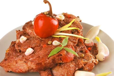 served beef on grey dish with gralic and pepper photo