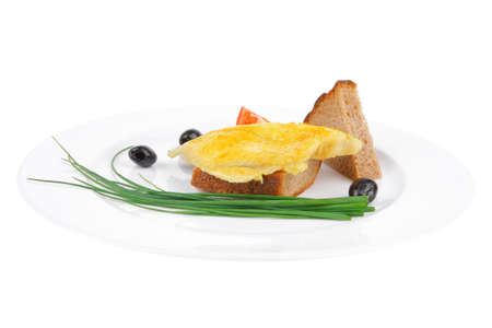 savory: fish fillet served over white plate with tomatoes,olives and bread photo