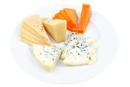 sustained: fresh aged french cheese parmesan roquefort and gruyere chops with slices on plate with isolated over white background
