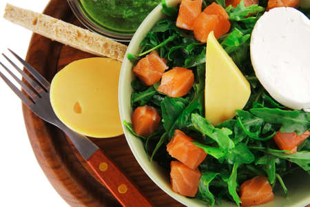 baby cutlery: green salad with salmon and tomatoes in green bowl
