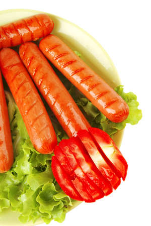 roast sausages on green dish over white Stock Photo - 21876964