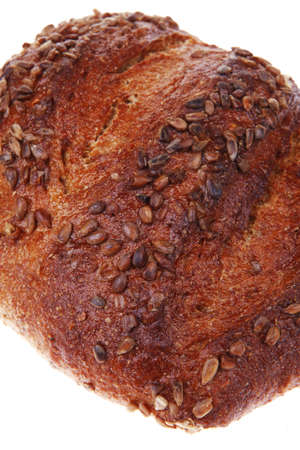 loaf of french rye bread topped with sunflower seeds isolated over white background photo