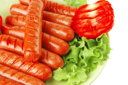 veal sausage: grilled sausages served on dish with tomato and salad Stock Photo