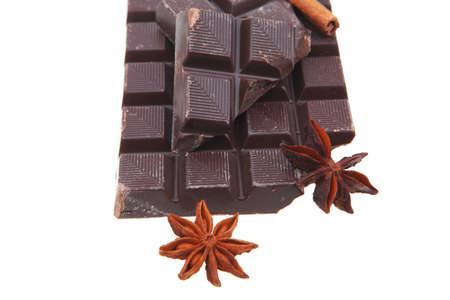 bar of dark chocolate isolated on white background photo