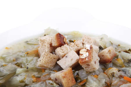 diet food : vegetable soup with bread  crackers in white bowl isolated over white background photo