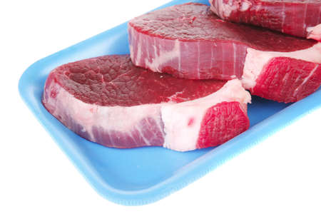 raw meat : fresh beef pork big tenderloin strip on blue tray isolated over white background photo