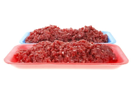 fresh raw mince beef meat on red and blue trays isolated over white background