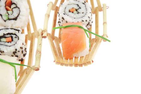 Maki Sushi and Nigiri - Maki Roll made of fresh raw Salmon, Cream Cheese and Avocado inside with Nigiri made of Salmon and Eel. Isolated over white background photo