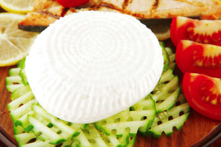 salmon pepper and greek soft cheese on wood Stock Photo