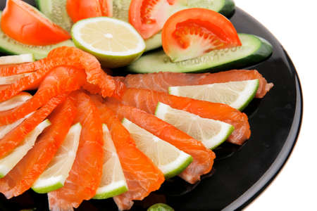 fresh smoked salmon served on black plate photo