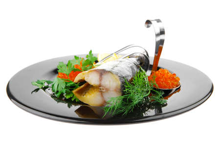 image of smoked mackerel on black plate with caviar photo