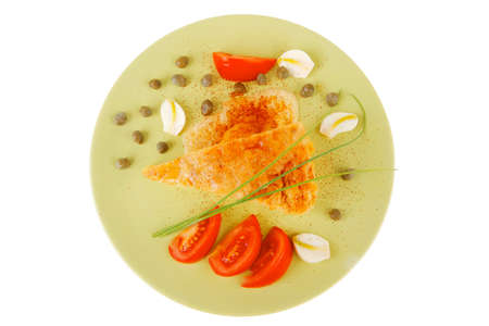 food : cheese casserole piece over green plate served with chives and tomatoes isolated over white photo