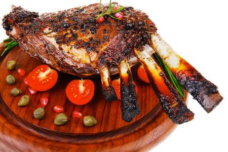 image of roasted ribs on wood over white photo