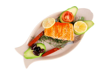 food: grilled salmon on big glass plate isolated on white background photo