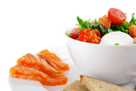 green salad with smoked salmon in white bowl on plate photo