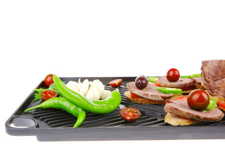 snakes on grill plate : tartlets with sliced meat and supplements isolated over white background Stock Photo - 22903519