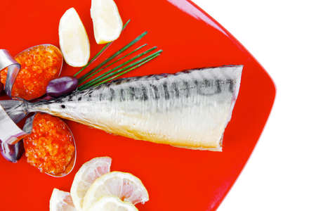 smoked fish with lemon and caviar on red photo