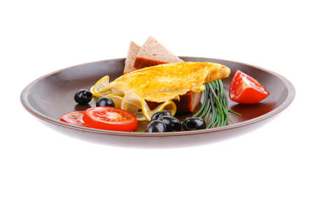 grilled fish fillet served with tomatoes,olives and bread photo