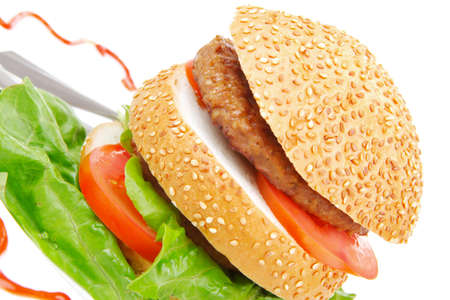 big double grilled hamburger on ceramic plate isolated  over white background photo
