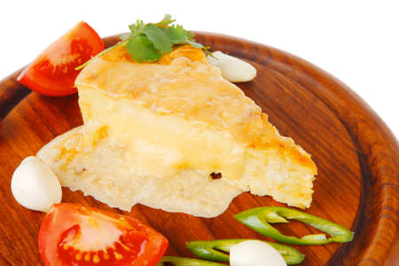 dairy food : cheese casserole piece on wooden plate tomatoes , chives , and garlic isolated over white background photo
