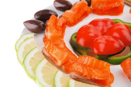 fresh smoked salmon slices on white with olives photo