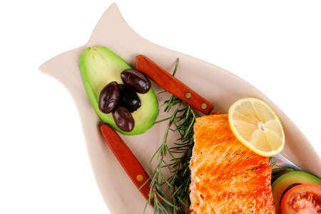 served fish: roast salmon fish over glass plate isolated over white background photo