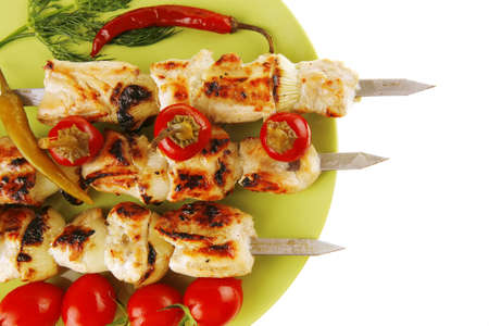 fresh roast shish kebab on green platter photo