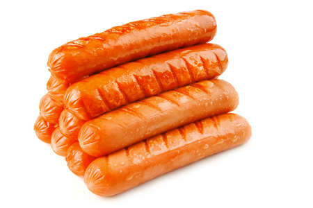 veal sausage: pyramide of grilled beef sausages over white background