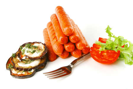 pyramide of sauages with vegetables over white photo