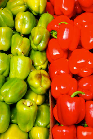 fresh raw lot of red and green of bell pepper on counter photo
