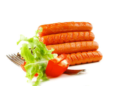 pyramide of sauages with vegetables over white background photo