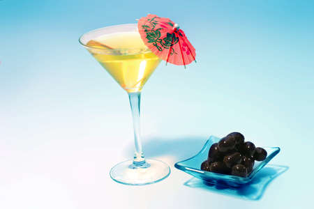 aperitive: martini glass with black olives Stock Photo
