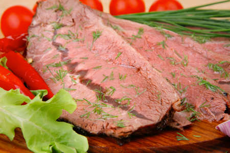 fresh grilled beef slice on wooden plate photo