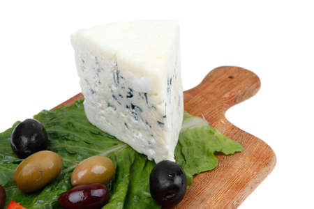 cheese platter: stilton cheese on wooden platter with olives and tomato isolated over white background