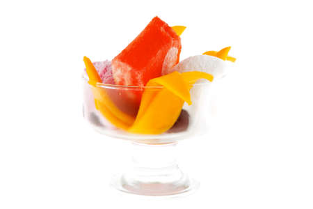 small transparent glass cup with ice cream and tropical fruits isolated on white background photo