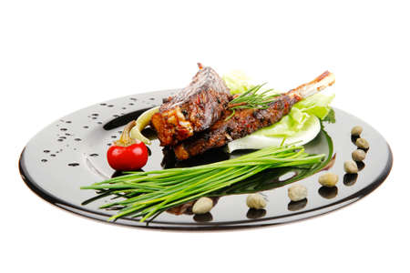 entree: served entree: ribs on plate with hot peppers and capers Stock Photo