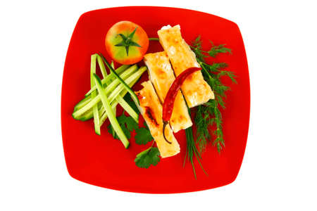 cannelloni in yellow cheese served with pepper and tomato photo