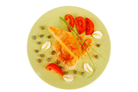 food : vegetable casserole triangle on green plate with cheese and tomatoes isolated on white photo