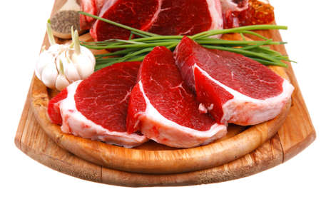 uncooked meat : raw fresh beef pork rib and fillet ready to cooking with garlic and green stuff over wood isolated on white background photo