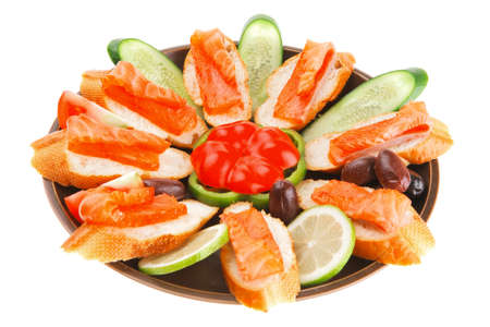 fresh vegetables with salmon on dark dish photo