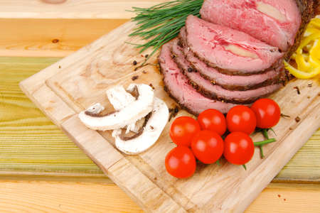 hot ham on wooden plate served over wood table photo