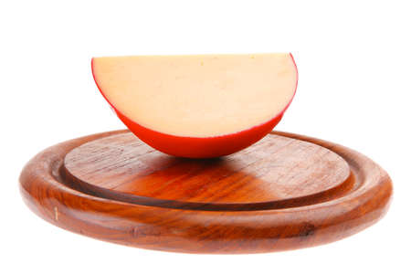 one cheese piece on wooden plate over white photo