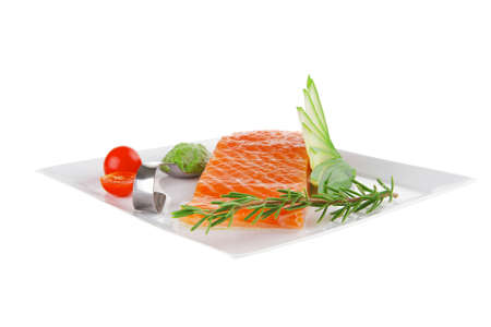 smoked salmon fillet isolated on plate with sauce photo