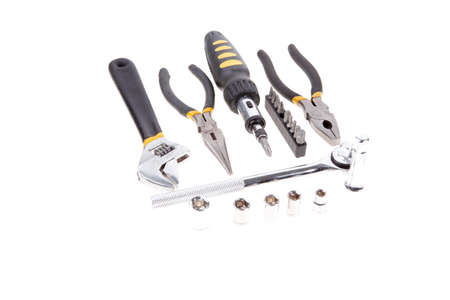 kit of tools include pliers wrench ratche handle bushs and bit driver photo