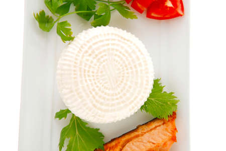 king salmon: soft goat feta salt cheese with grilled sea salmon tomatoes and green lettuce salad served on white china plate isolated on white background