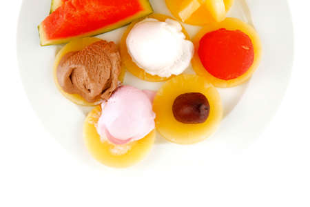 brylle: watermelon plum and slice of pineapple and chocolate and fruit ice cream on white plate isolated over white background